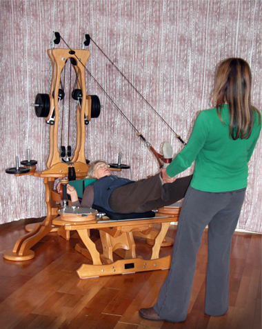 Hamstring series using the upper straps of the GYROTONIC® Pulley Tower.